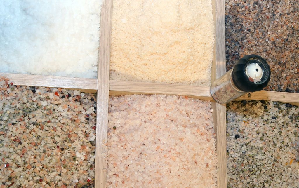 50600206 - large grains of himalayan salt sale in spice shop and food